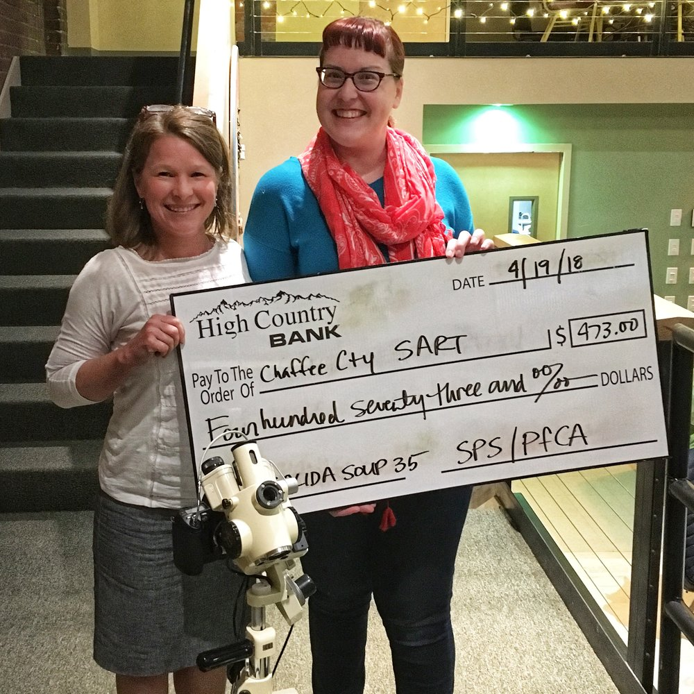 Planned Parenthood nurse Karen Adamson (l), and manager Shelley Schreiner hold up the Big Soup Check tallying the winnings they earned for the Chaffee County SART (Sexual Assault Response Team) at Salida Soup 35. The money earned will go towards new support technologies.