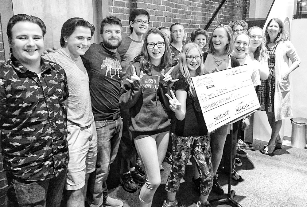 Members of the cast of  Little Shop of Horrors , the first SHS musical in 18 years, pose with the Big Soup Check after their win on September 20th.