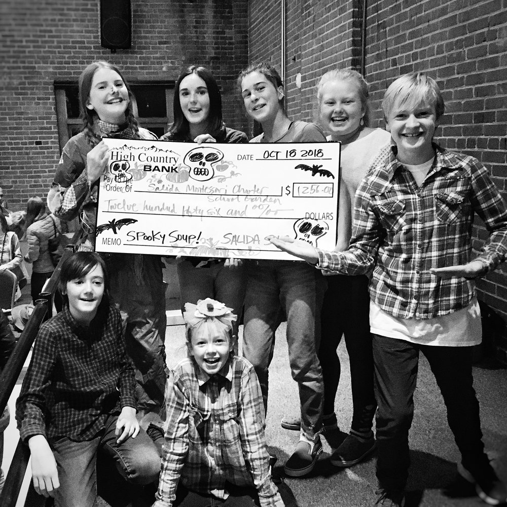 Salida Montessori Charter School students pose with the Big Soup Check after their win at Spooky Soup. They asked nicely, so we let them keep the big check. No, really.