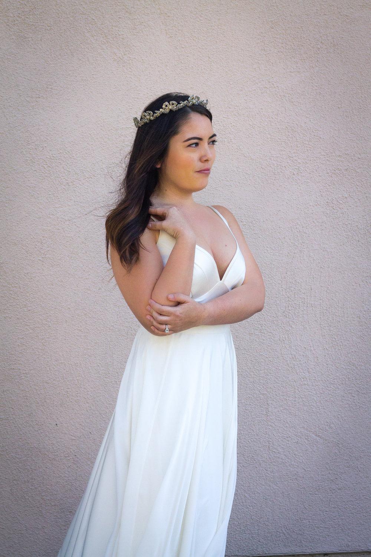 Dress: Suzanne Neville | Overskirt: Theia | Headpiece: Maria Elena | Earrings: Maria Elena