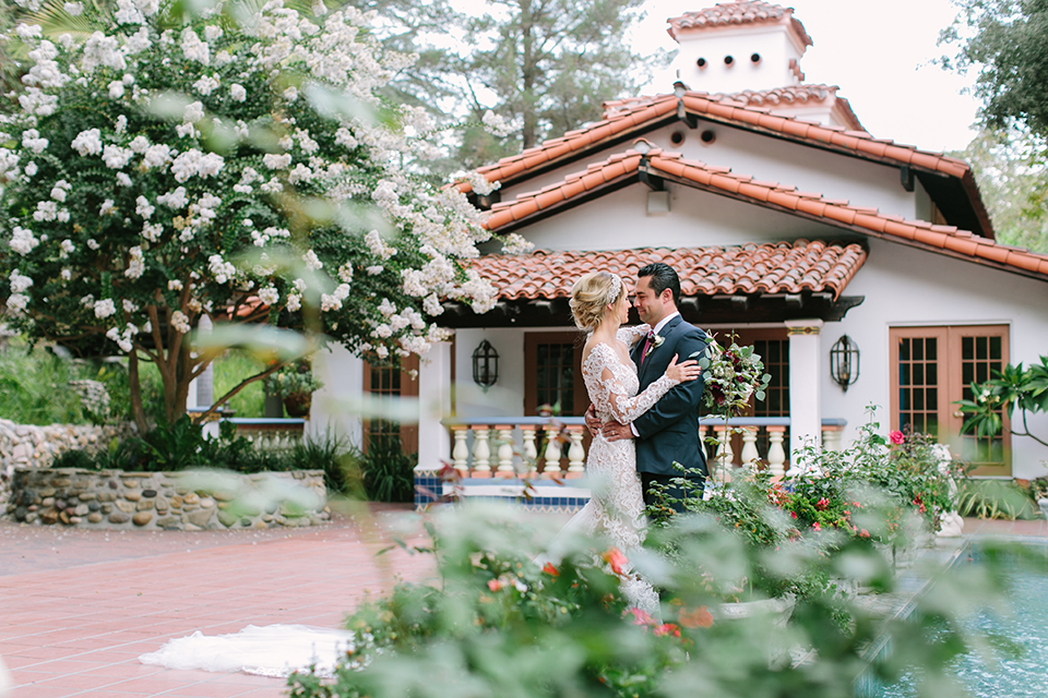 Orange-county-wedding-shoot-at-rancho-las-lomas-bride-and-groom-hugging.jpg