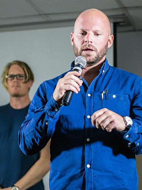 Andrew Watkins-Ball, one of Africa's most exciting entrepreneurs, at an event in 2017. And that's Fred, our founder in the background. He's trying to pick something out of his back molars with his tongue.