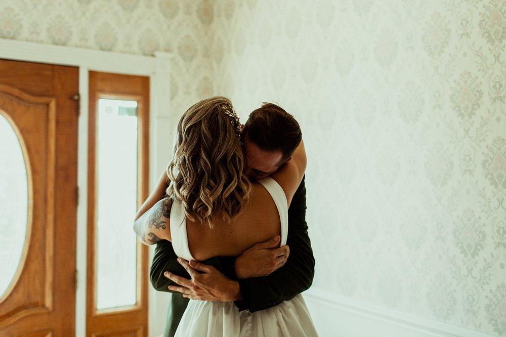 groom hugs bride during first look nashville airbnb wedding