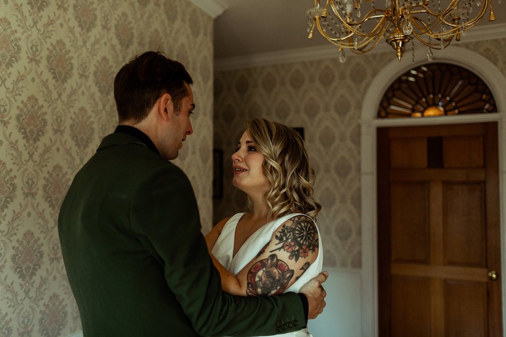 bride and groom emotional first look with tears
