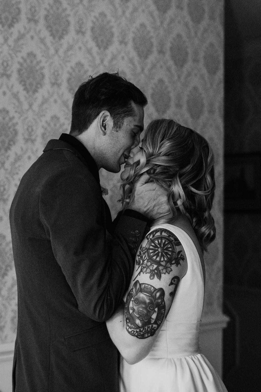 groom kisses bride during emotional first look nashville