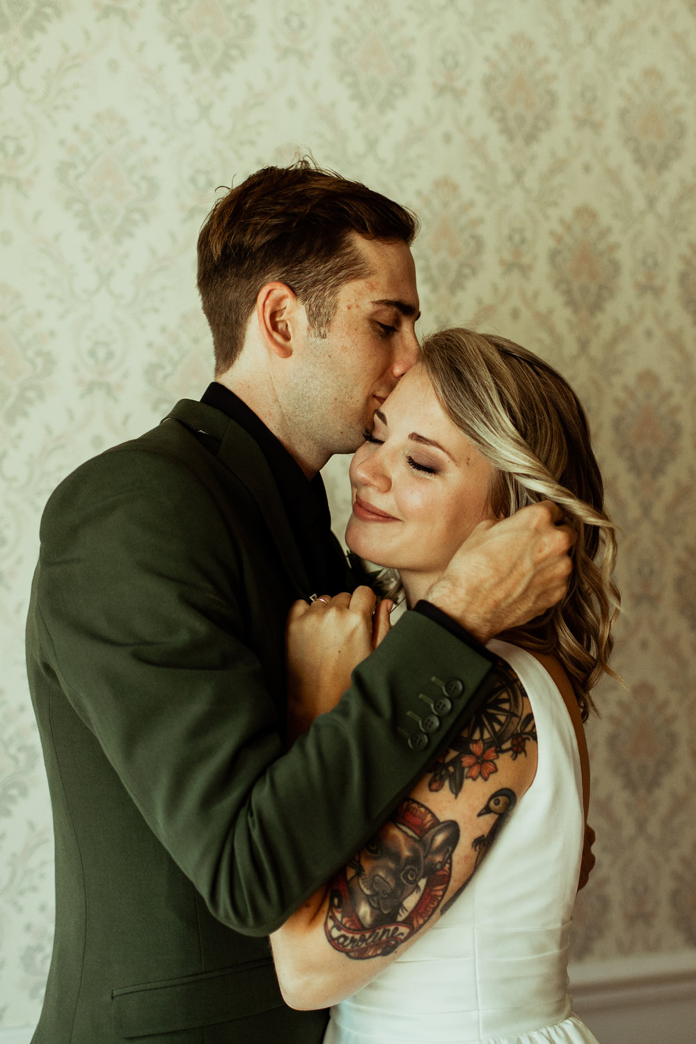groom kisses bride on forehead during first look nashville