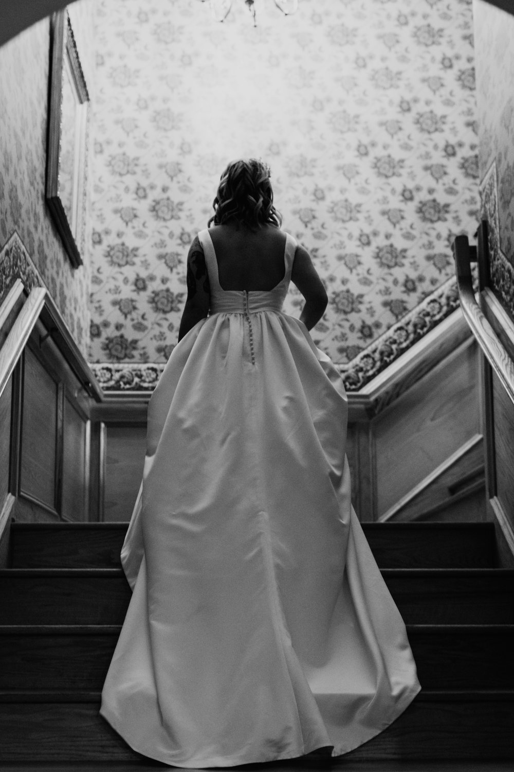 bride in ball gown on staircase