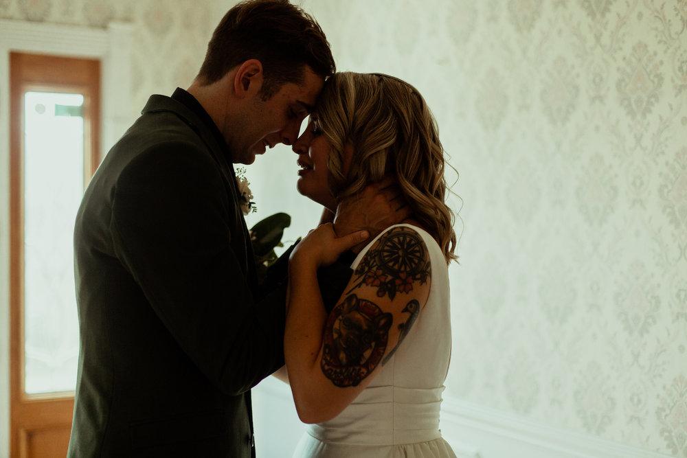 bride and groom emotional after wedding ceremony in nashville