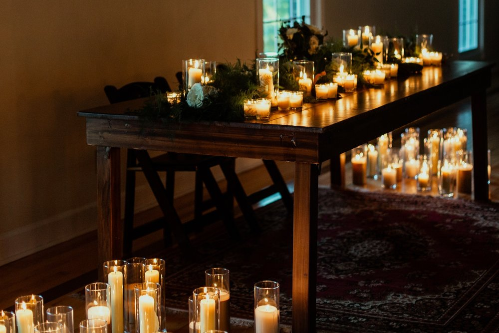 sweetheart table with candles and greenery