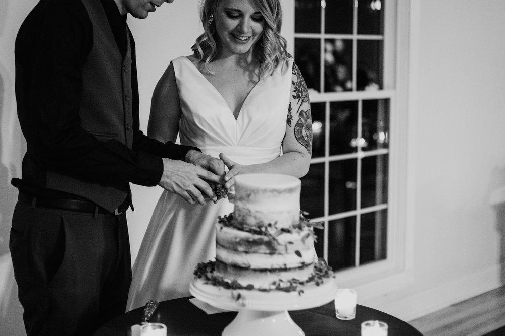 bride and groom cut wedding cake in nashville