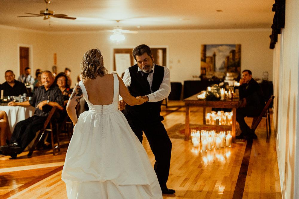 bride dances with dad on wedding day