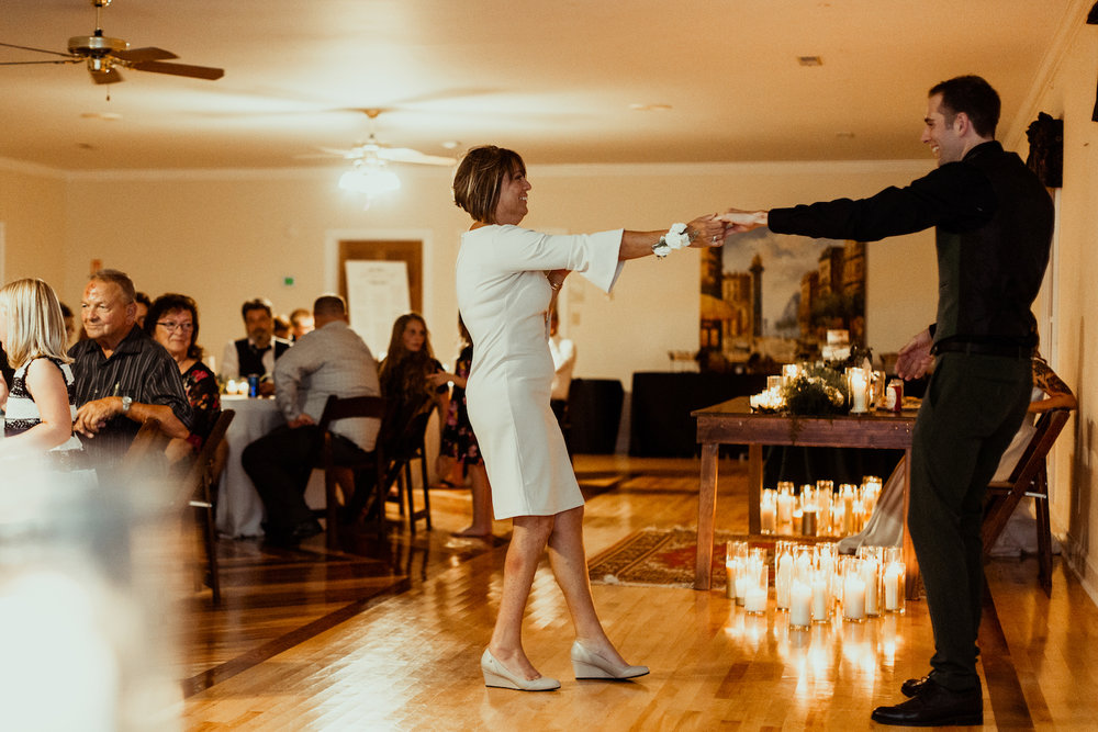 groom dances with mother on wedding day