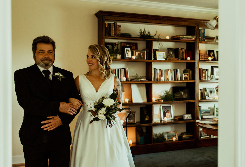 bride and her dad prepare to walk down the aisle