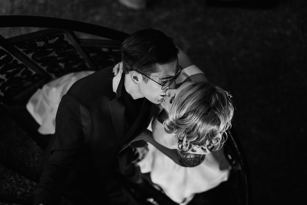 newlyweds kiss on circular stairs