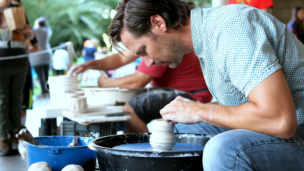 Jeff Picou focuses in as he works on forming a cup or small vase.
