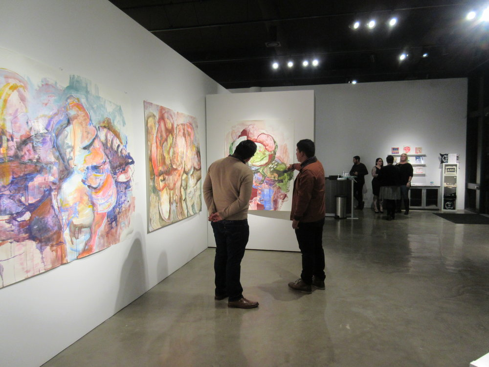 Visitors debate the art