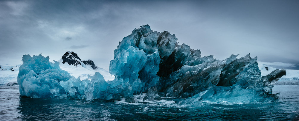 "Crystal Ship. Curtiss Bay, Antarctica    by Rollence Patugan, $1,200  20"" x 38"""