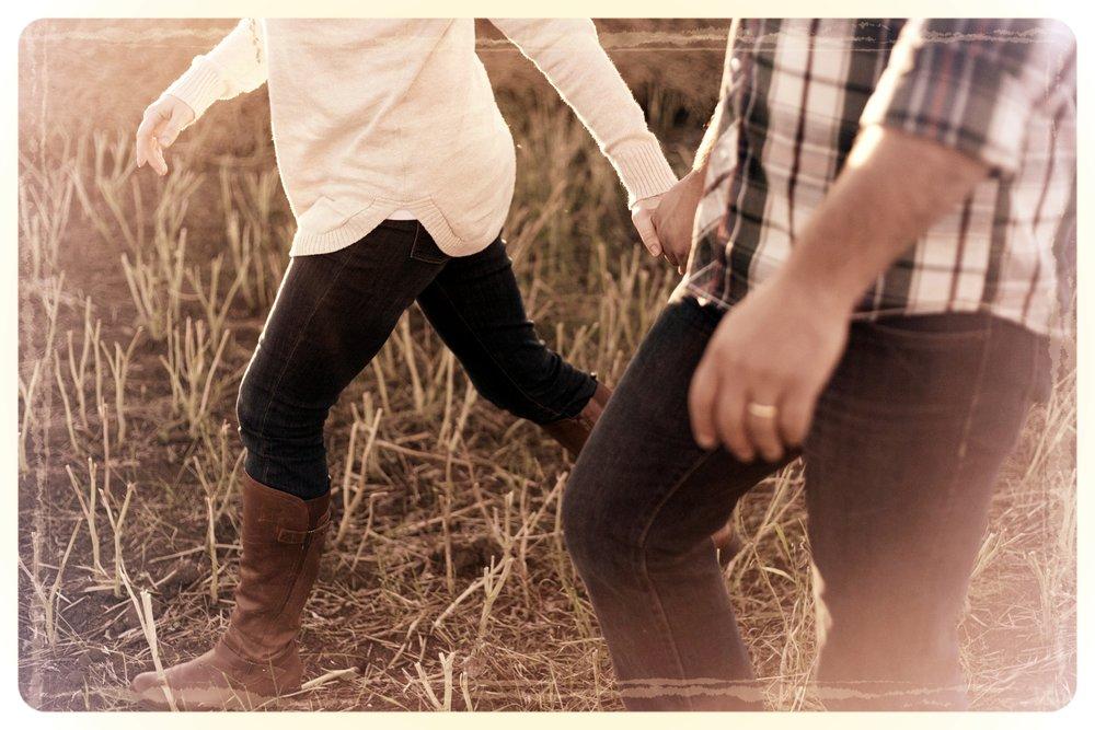 couple walking in grass.jpg