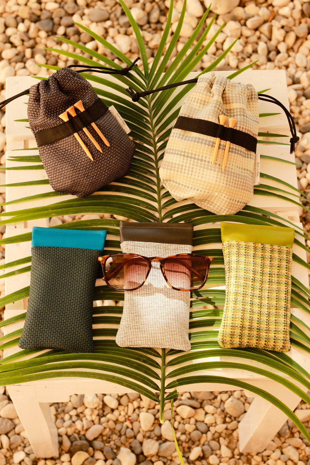 Golf ball/tee bags, glasses cases, tote bags and wine bags have been the top sellers for business gifts!
