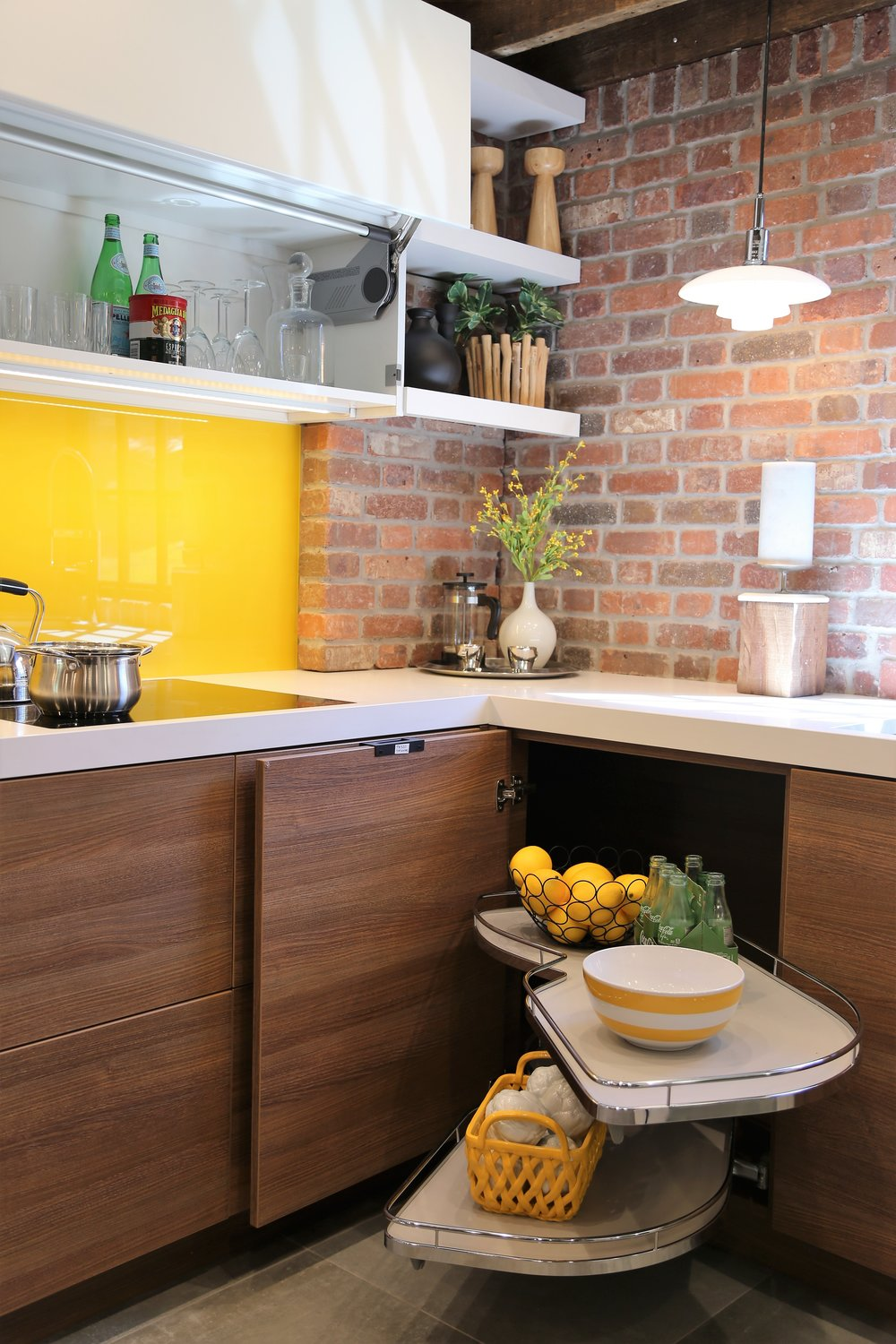 Accessibility - Upper cabinet doors open and close with a push of a button while lower cabinets are open with a push.  The corner cabinet is easily accessed with a Lemanns II swing out basket.