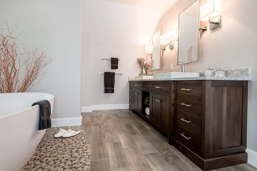 Natural Calm - As a room to prepare for a busy work day and as a space to unwind from stressful day this master bathroom delivers with plenty soothing natural elements.