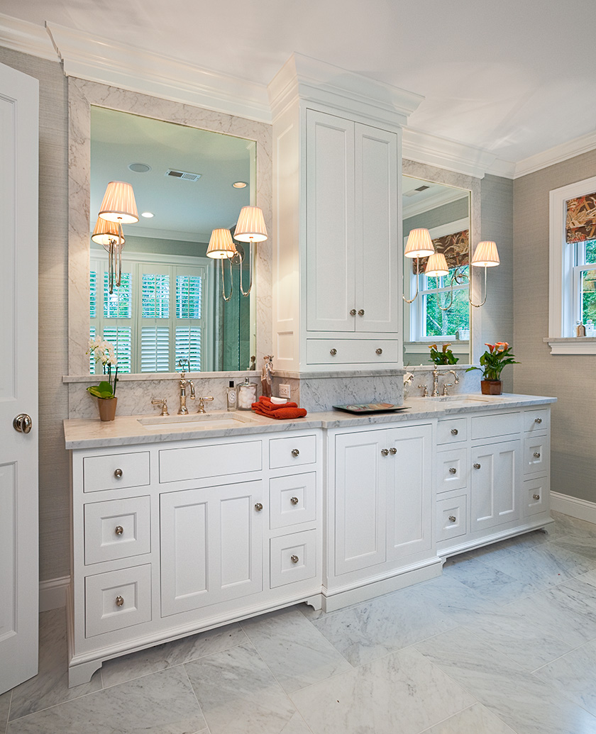 Traditional Elegance - A white painted cabinet, marble counters and floors make this master bath timeless and elegant.