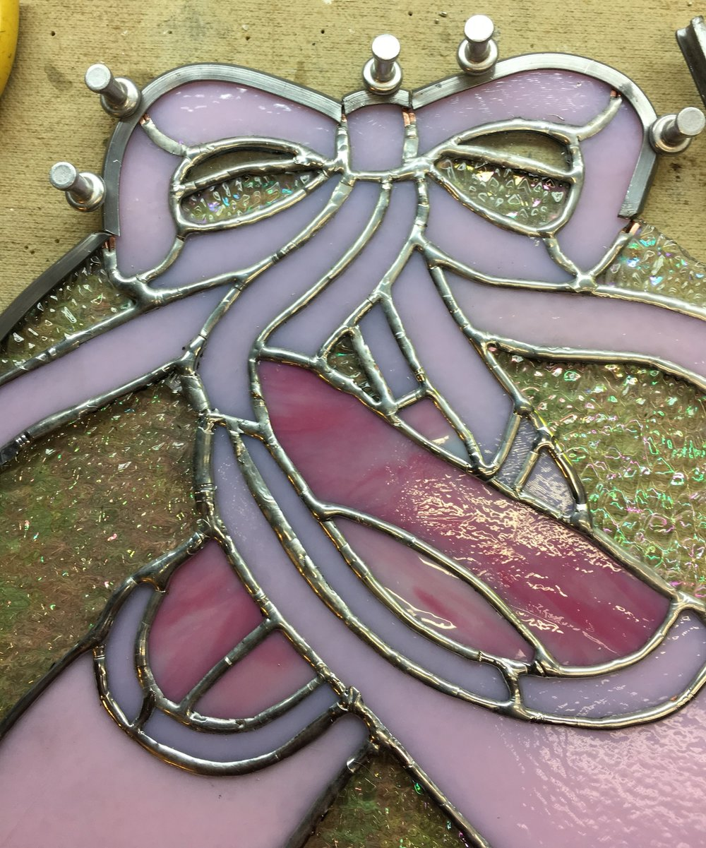 Here's a section of the ballet slipper panel I'm working on for my coworker - I don't want to share a whole picture until she receives it!