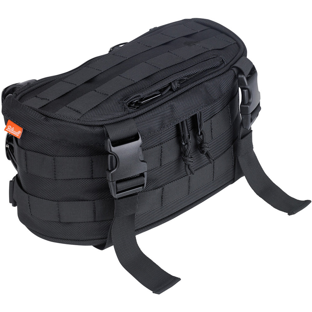 This universal fit utility bag was designed with the daily commuter in mind. It's small size allows and MOLLE mounting system allow it to fit just about anywhere on any motorcycle. Built to hold your essentials, this bag is a great place to store sunscreen, tools, cell phone and other various personal items you might want to secure but keep easily accessible. The straps hanging off the front are often used for bed rolls, camping pads or for stripping off and storing a layer when the weather heats up. MSRP: $69.95
