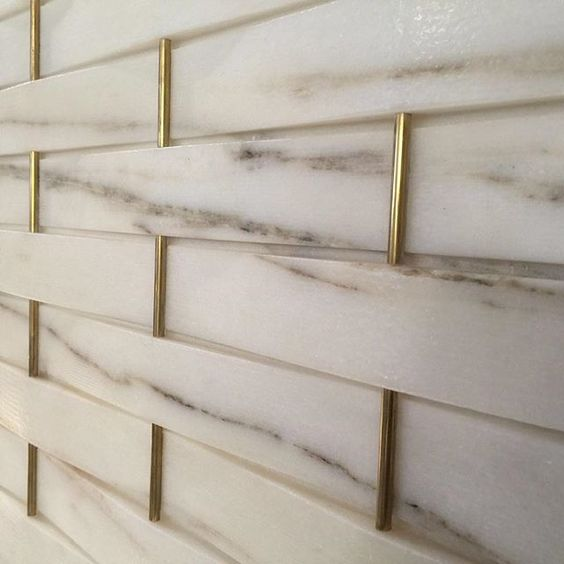 I love the look of marble subway tile paired with brass inlay to glam up a backsplash, wall, or even a floor. How gorgeous would this look in a chevron pattern with a flat inlay as a bathroom floor?