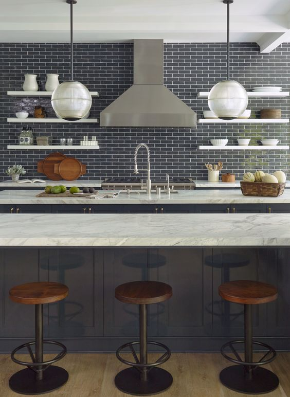 As much as I love statement tiles that are fun and colorful, I also love the idea of a simple glazed ceramic tile. The glaze makes it more of a show stopper while the lack of pattern still allows it to be a great option for tiled wall or backsplash. I am loving this kitchen and its simplistic yet chic style. I would definitely do a patterned tile on the floor in this kitchen to mix it up.