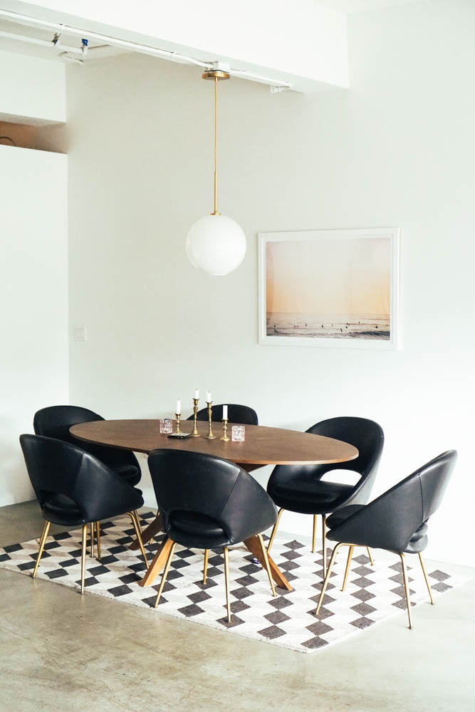 See how the light fixture, table, art, and paint color make such a huge difference?! I love this Pendant from West Elm. You can shop it below if you love!