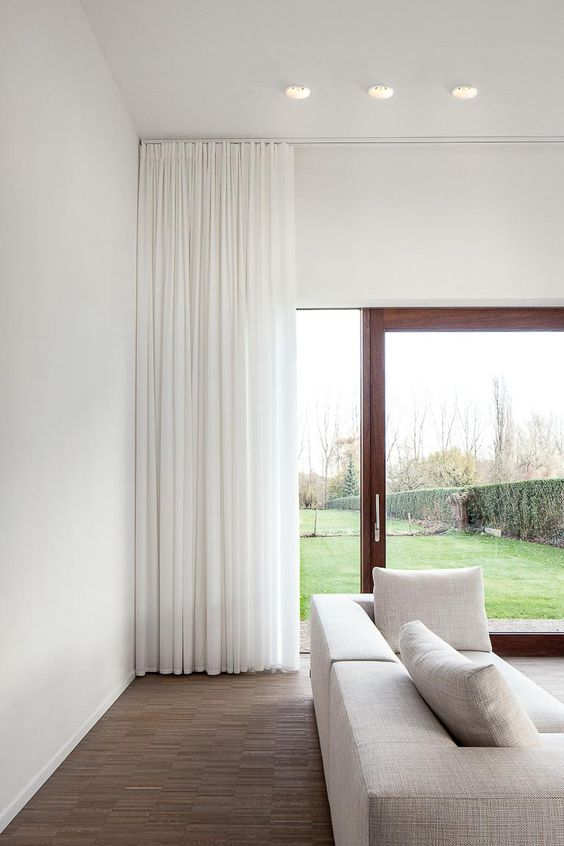 I have been a huge fan of these modern ceiling track drapes. They make the room feel taller and bigger and feel very chic. I feel like these are drapes you would see in a very upscale hotel or in a super cool Hollywood Hills home. Also, see how they just kiss the floor?