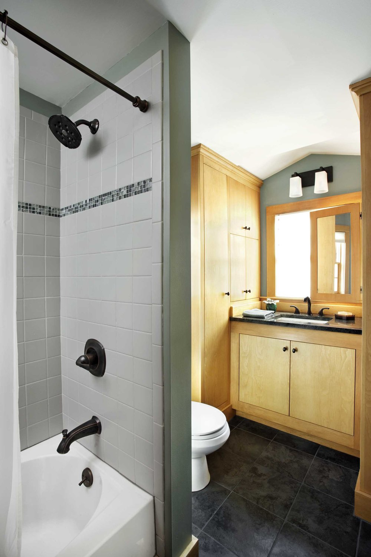 Bathroom w/ custom cabinets.