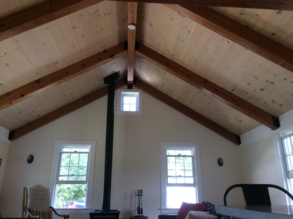 Great room. Reclaimed Heart Pine beams.