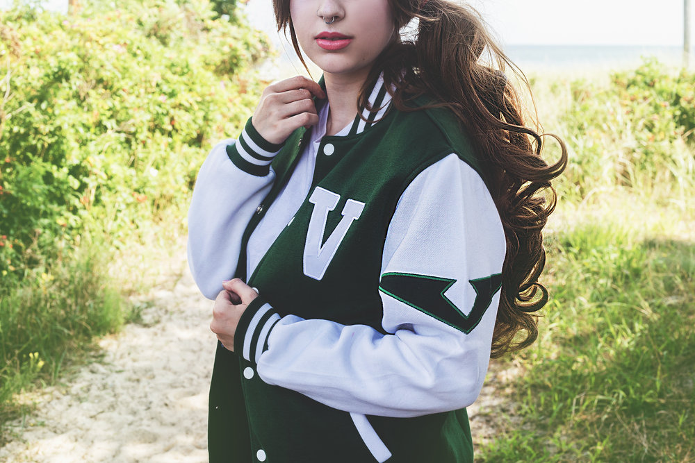 Aesthel wearing the Pidge Varsity Jacket in size XS | Photo: Emily Rey