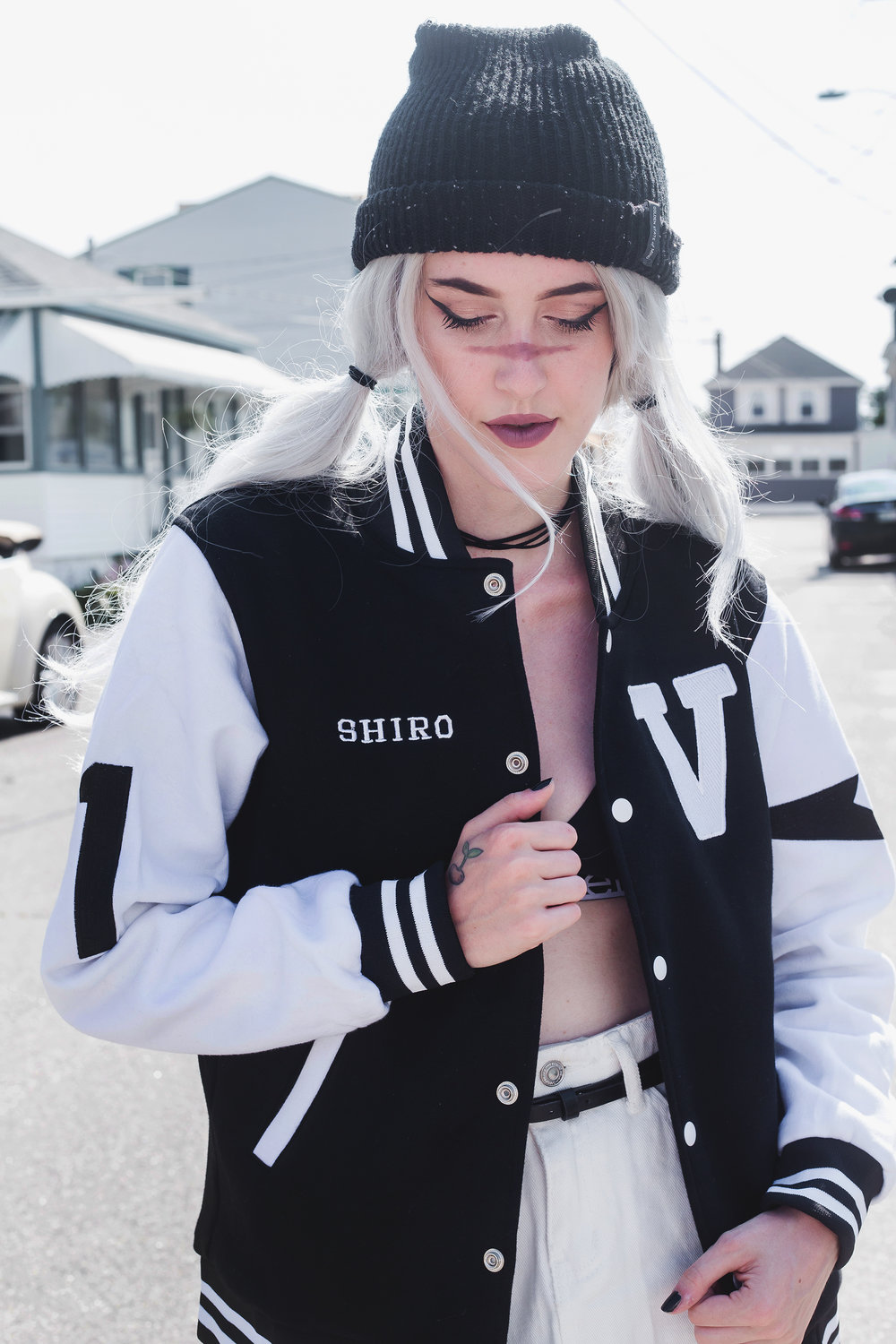 Emily Rey wearing the Space Daddy Varsity Jacket in size XS | Photo: Aesthel