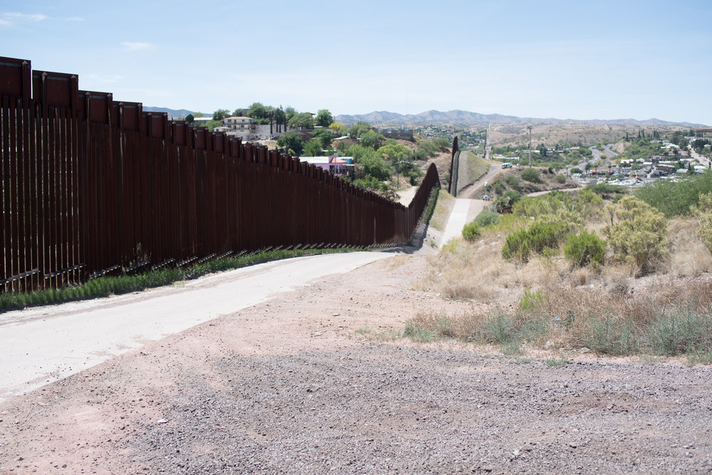 The wall was installed in more geographically accessible regions of the border, such as Nogales, Arizona, pushing migrant routes into areas that had not historically been trafficked.jpg