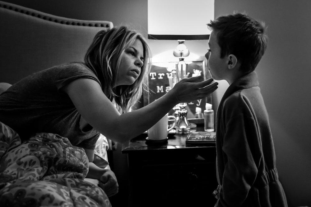 Mom checks her son's chin