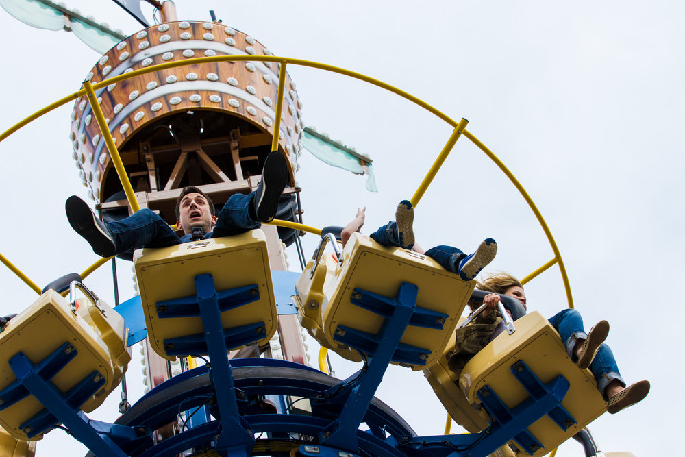 Man is surprised while riding a carnival ride