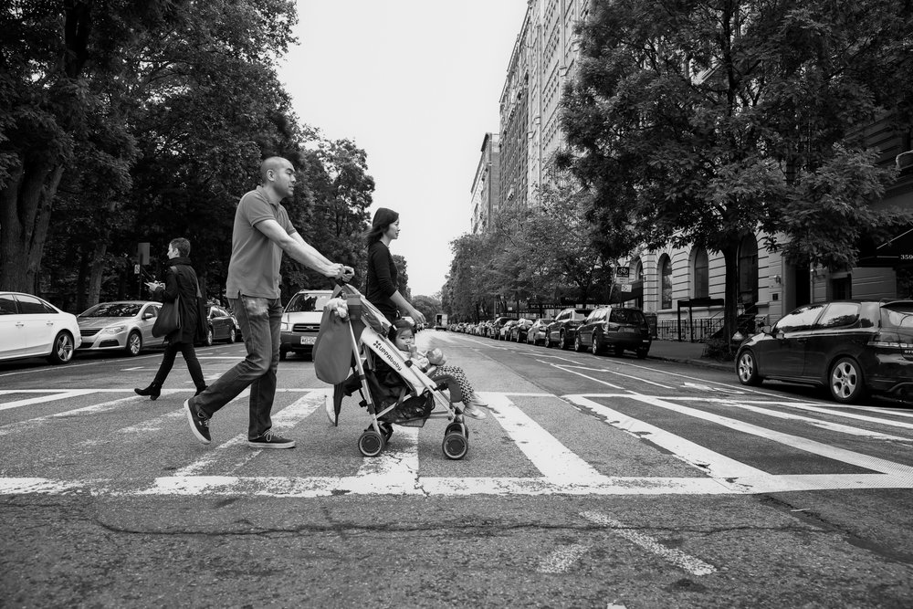 Family of 3 crosses the street in NYC