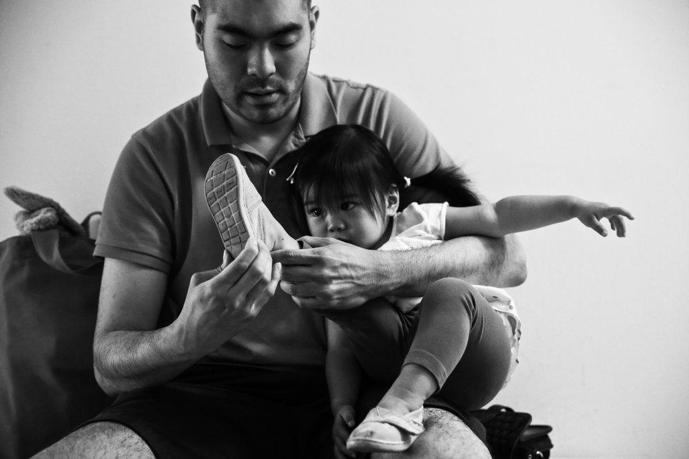 Man puts shoe on girl