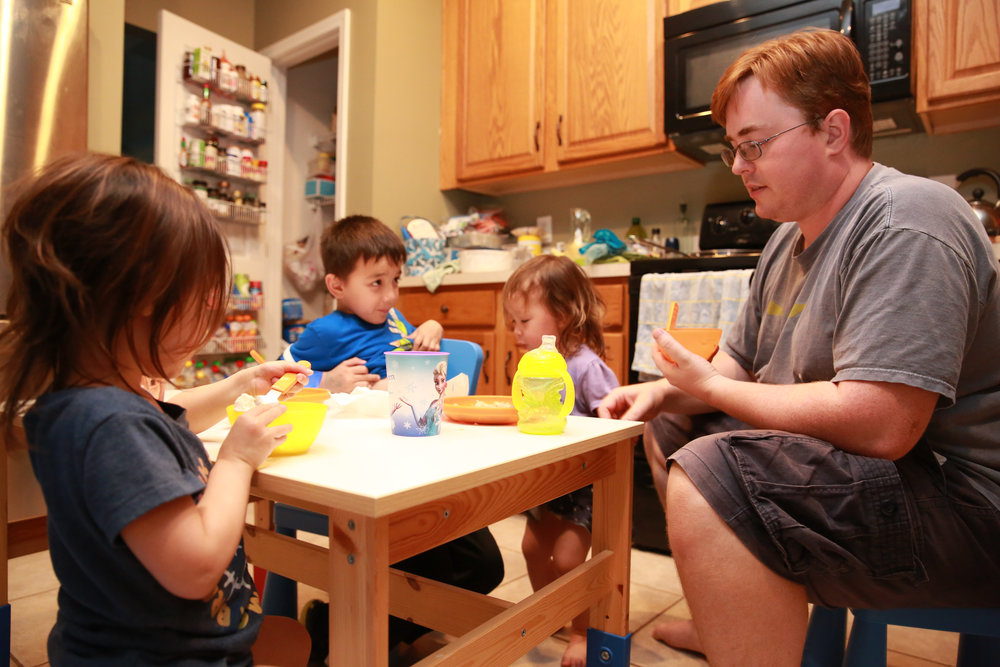 Brock joins John, Finlay, and Viola for dinner at the cousins kiddie table