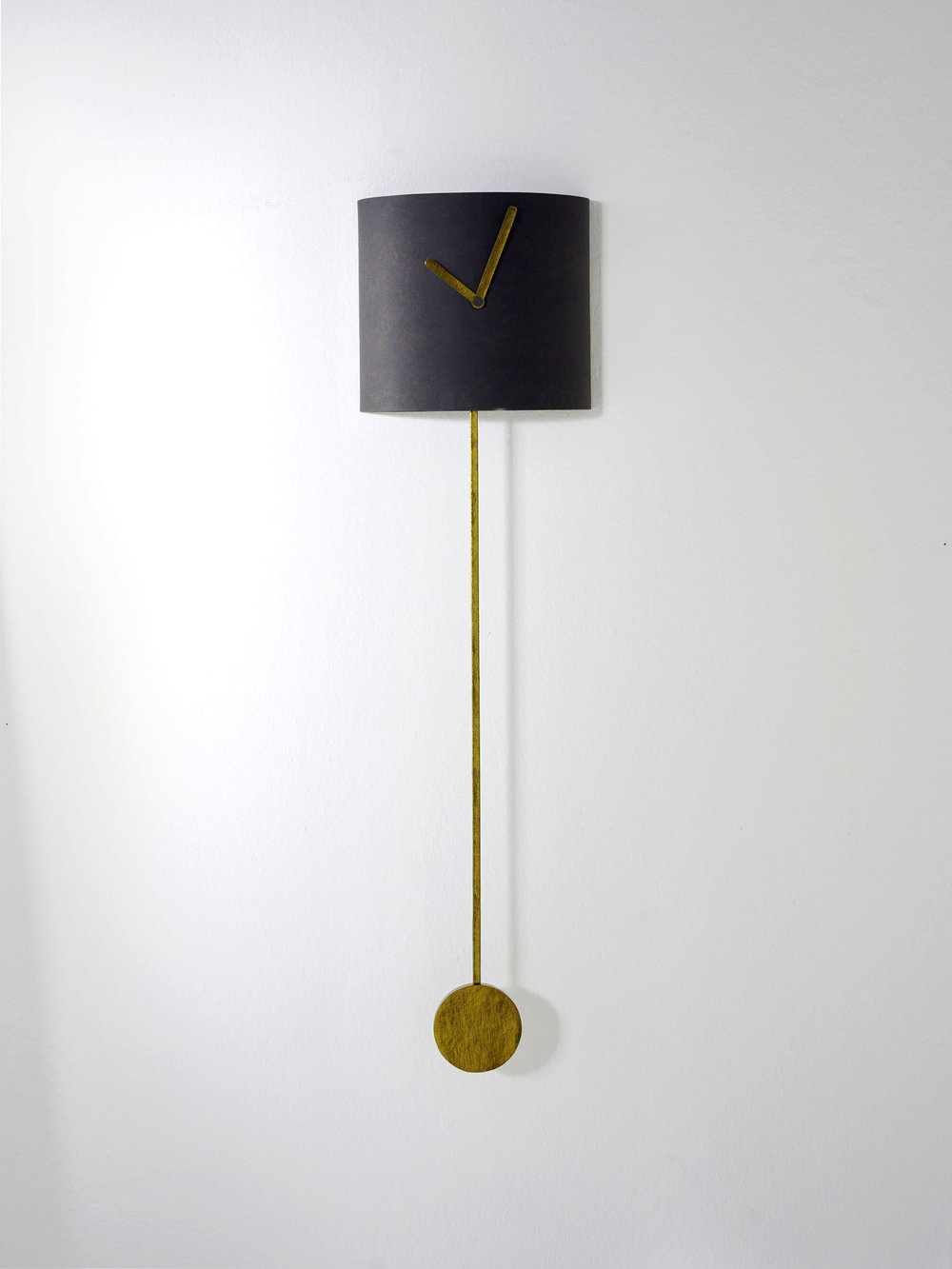Halfpipe - width: 25.5cm depth: 13cmlength with pendulum: 97.5cmBody in black.Clock hands and pendulum in old gold.Each clock is made by hand.