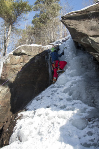 Aislinn Sarnacki |  BDN   Jack Main, 15, of Camden scales a wall of ice on Dec. 20, in Camden Hills State Park while learning to ice climb with Equinox Guiding Service.