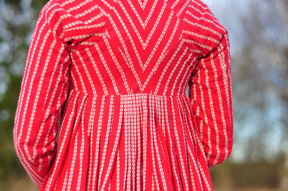Empirklänning i bomull, sydd av Maja Satz.Originalet hittar ni på Nordiska Museet och har inventarienummer NM.0033953. Foto: Peter Ahlqvist