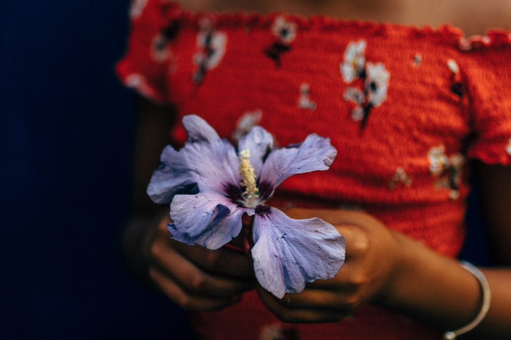 safiya with flower.jpeg