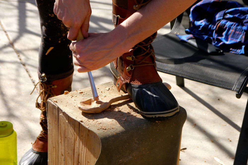 A participant carves a spoon during a Living Arts School adult workshop.