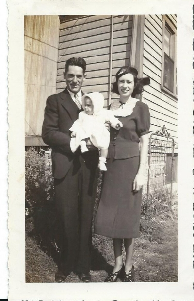 Mom at about 6 months with her parents in Detroit