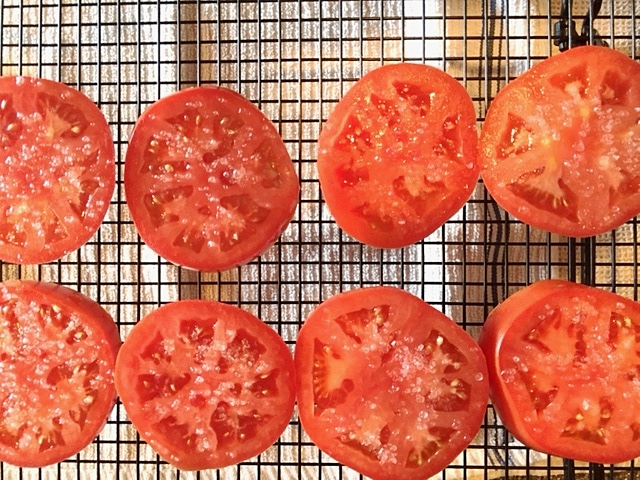 Salting the tomatoes!