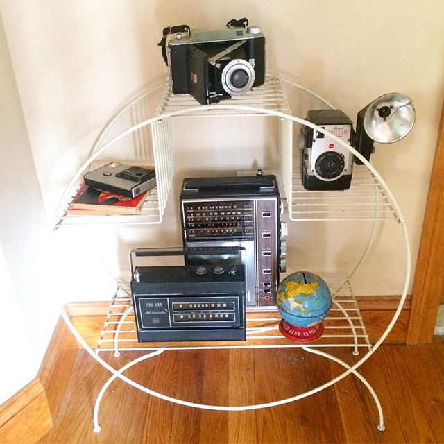 Plant stand, camera stand, what's the difference. . . . #goodguyco #vintage #vintagehome #vintagestyle #oldcamera #plantstand #vjntageradio #kodak #boho #eclectic #menstyle #interiorsformen #apartmentdecor #interior #boston #allston #allstonvintage #styling